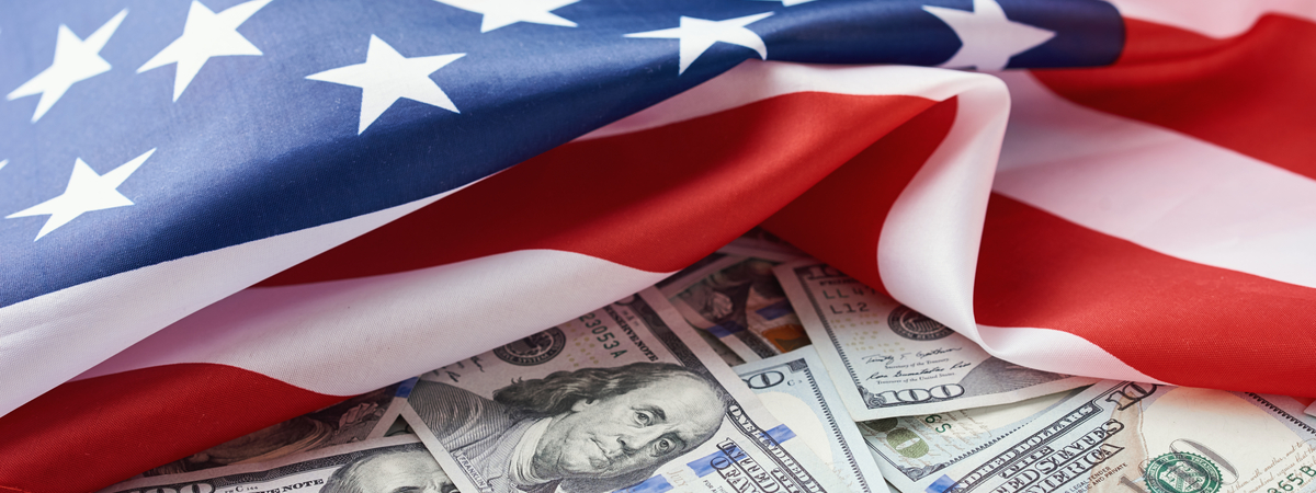 USA-national-flag-and-dollar-bills.-Business-and-finance-concept